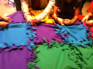 children making blanket
